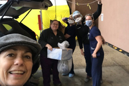 Photo of faulty and staff delivering personal protective equipment to Einstein Medical Center