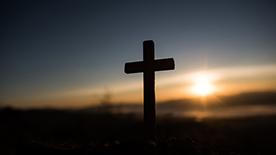 Catholic cross at sunrise