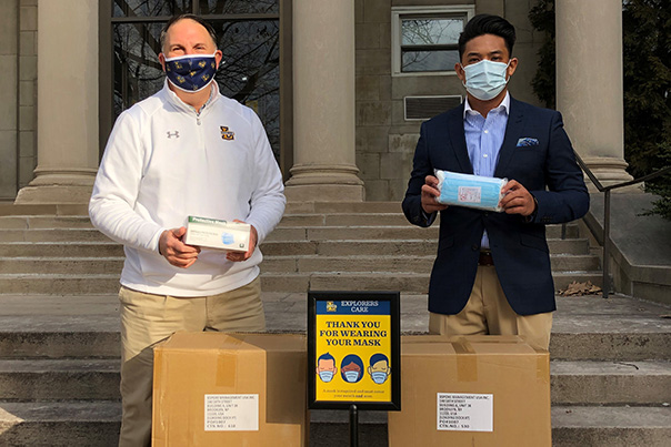 "Trans ""R.J."" Lualhati and Dan Joyce with face masks packages"