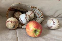 baseballs and apple