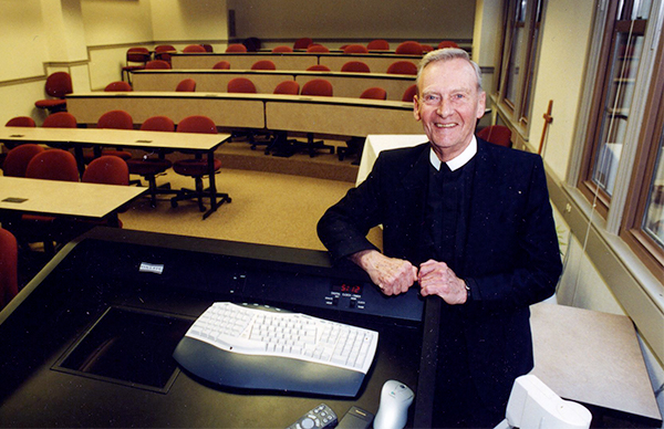 Emery C. Mollenhauer, FSC, Ph.D. standing for photo in a classroom