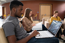 Students studying in the Founders' Hall atrium